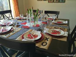 dining room archives frazzled joy i used my black and white gingham table runners that i made at thanksgiving i added some kraft paper placemats red chargers white napkins and plates