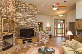 room with stone fireplace living room design ideas stone tile