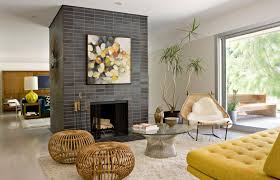 grey tile fireplace wall with painting on over mantel added by