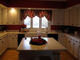 before kitchen no backsplash just red walls white cabinets