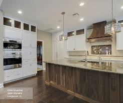 kitchen island with cabinets white cabinets with a walnut kitchen island masterbrand