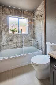 frameless glass door and panel a bathtub