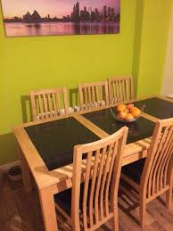 quick sale light oak dining table with granite inserts and 6