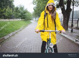 raincoat for bike riders bicycle ride rain young woman raincoat stock photo 648571588