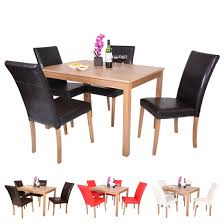 oakden oak veneer dining table and 4 x faux leather high back