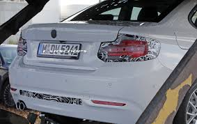 facelifted 2018 bmw 2 series coupe spotted hanging out on a truck