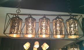 Rectangular Lantern Chandelier Mercury Glass And Iron Elongated Chandelier The Designer Insider