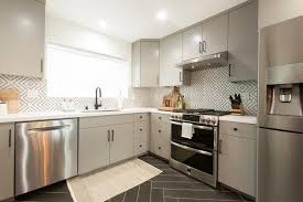 white kitchen cabinets black tile floor gray mid century modern kitchen with black tile floor hgtv
