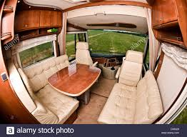 motor home interior seating area and table in concorde luxury motorhome interior stock