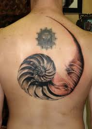 geometric nautilus shell tattoo design on upper back golfian com