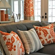 Orange Sofa Throw Grey Sofa With Orange Pillows Floral And Stripes Modern