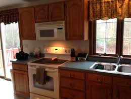 what color countertops with oak cabinets what color walls oak cabinets and blue green countertops