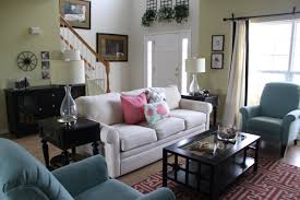 living room photos near the stairs and a vase of flowers on the