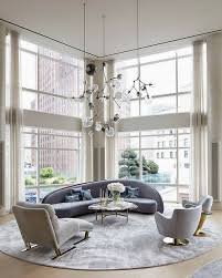 living room with curvy sofa and round rug hupehome