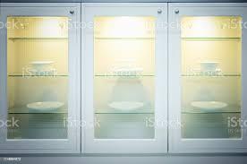 glass door kitchen cabinet lighting kitchen modern cupboard with glass doors and lighting stock photo image now