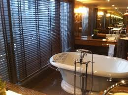 modern hotel bathroom great white acrylic oval sink on black top small vanity table feat