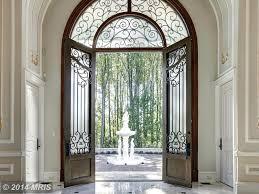 art deco front door with exterior stone floors u0026 fence in potomac