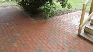 Paver Patio With Retaining Wall by Retaining Walls Northern Michigan Hardscapes Northern Michigan
