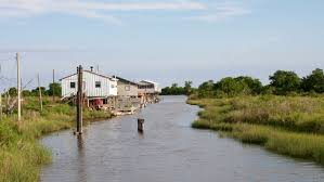 rising seas are washing away two us towns how they u0027re responding