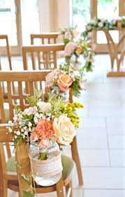 wedding flowers jam jars rustic orange and wedding flowers and cake at rivervale barn