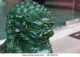 jade lion statue jade lion statue on blur stock photo 261456713