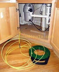 how to wire an electrical outlet under the kitchen sink fishing cable