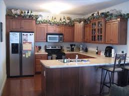 ideas for decorating above kitchen cabinets with