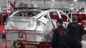 tesla says it will build 500k cars a year by end of 2018 can it