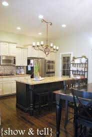 white kitchen black island white cabinets with soapstone counters black island with carerra