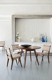 dark dining room transparent blue bottles as decoration white wood wall circle dark