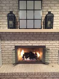 diy glass fireplace doors at brick wall design with opened double
