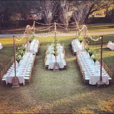 diy backyard wedding in the woods reception string lights first