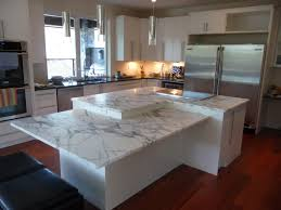 island in the kitchen two level kitchen island in arabascato marble and perimeter tops in