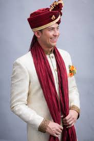indian wedding groom grooms groomsmen photos groom in ivory sherwani with turban