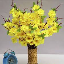 Yellow Fireplace by Little Yellow Flowers Glued To Fake Curly Willow Branches In Glass