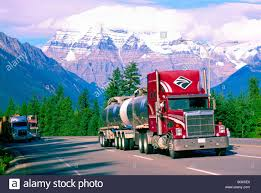 semi trailer truck semi trailer truck lorry driving on yellowhead highway 16 at