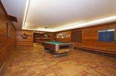 retro wood paneling here s a vintage basement rec room with wood paneling basement