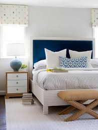 blue headboard with burlap x stools transitional bedroom