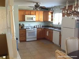 painting my kitchen cabinets blue makeover monday i painted my kitchen cabinets shades of