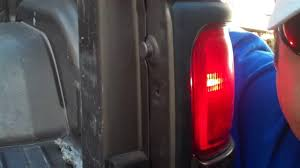 2015 dodge ram 1500 tail light bulb replacement how to put a tail bulb in a dodge ram 1500 truck youtube