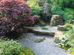 the careful landscaping in a japanese garden invites one to stop