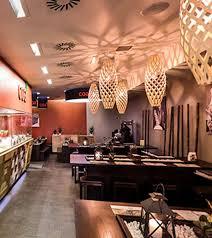 david trubridge hinaki pendant lights at a restaurant in denmark