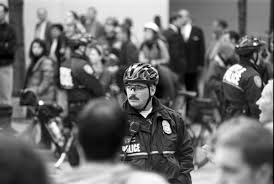file police officer at wto protest 1999 22782392376 jpg