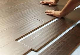 Vinyl Laminate Wood Flooring Laminate Vs Vinyl Vs Tile Flooring Bob Vila