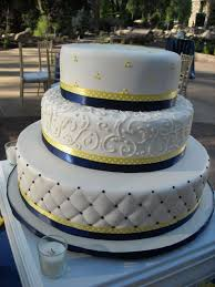 sunflower themed wedding cake or blue and yellow cake