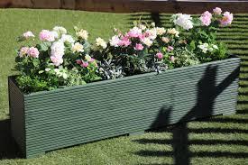 wooden garden planter trough painted in cuprinol green 150cm long