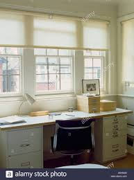Home Office Desk With Storage by White Blinds At Window Above Black Chair And Desk With Storage