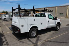 white convertible jeep 96v service body with cargo rack titan truck