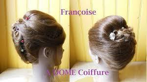 Elegant Chignon Hairstyle by Coiffure