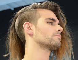 a side part with long hair and a swoop and a cross long curly hairstyles and haircuts guide for men long hair guys